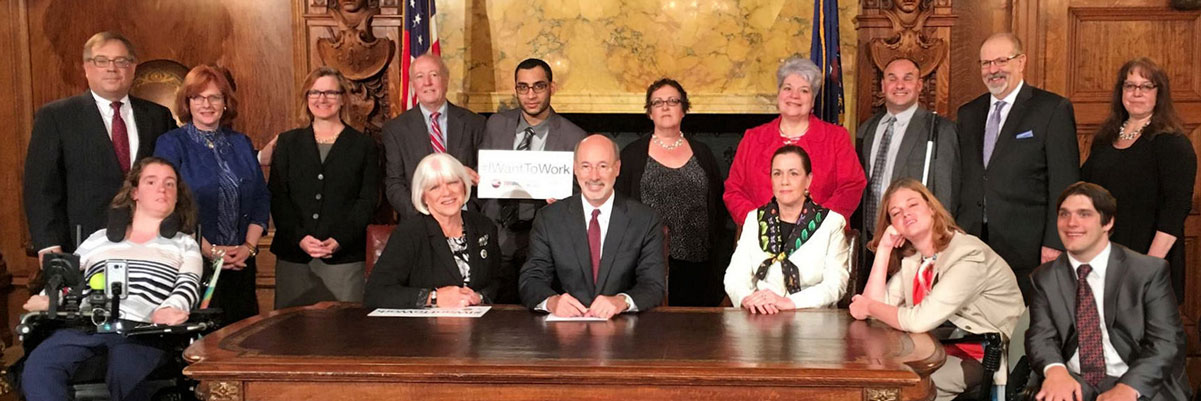 group in court house signing bill