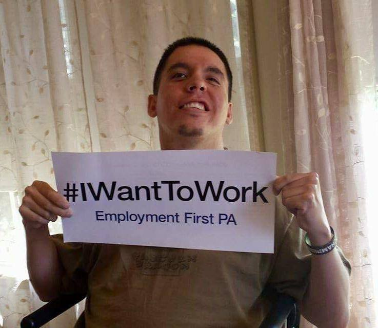 Kyle with I Want To Work sign
